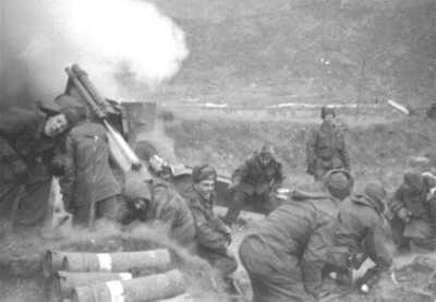 Ed Milburn pulling the cord on the first round the 623 fired in Korea