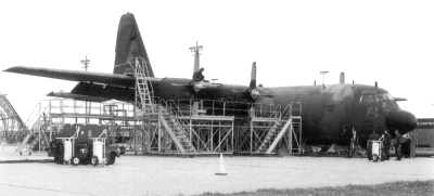 Maintenance on the outside of C-130 of the KyANG
