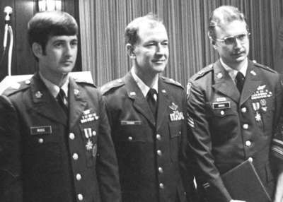 Adjutant General Frymire with Ross, at left, and Cross, at right, after awarding them the Kentucky Medal for Valor